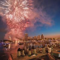 Watch fireworks from the bank of the river